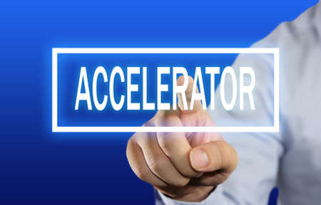 accelerator: Business concept image of a businessman clicking Accelerator button on virtual screen over blue background Stock Photo