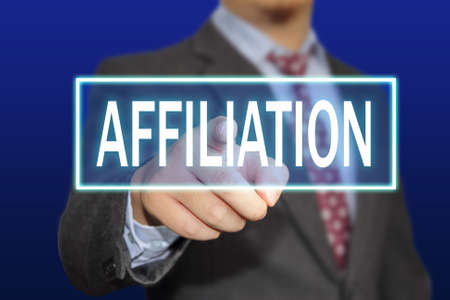 affiliation: Business concept image of a businessman clicking Affiliation button on virtual screen over blue background