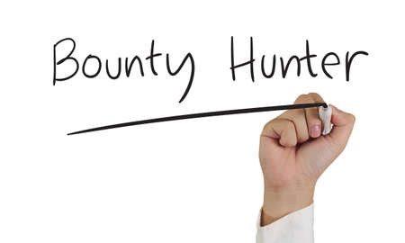 bounty: Business concept image of a hand holding marker and write Bounty Hunter isolated on white
