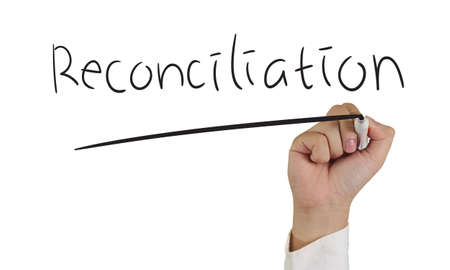 reconciliation: Business concept image of a hand holding marker and write Reconciliation isolated on white Stock Photo