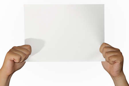 placard: Hands of a man holding up an empty paper isolated on white Stock Photo