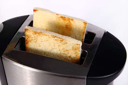 toaster: Food photography closeup photo of bread toast in toaster machine