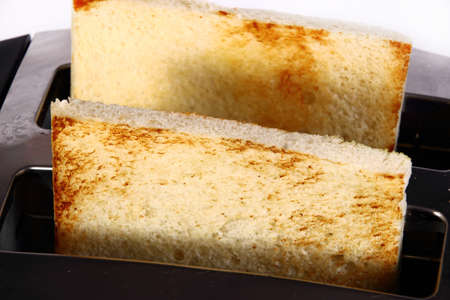 food photography: Food photography closeup photo of bread toast in toaster machine