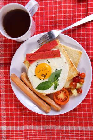 bullseye: Food photography closeup photo of bullseye egg on bread toast with sausage and smoked beef