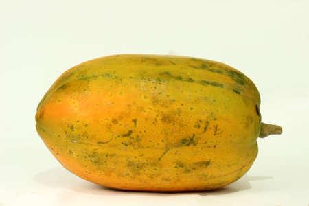 white yummy: Whole orange papaya fruit over white background