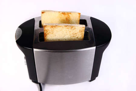 food photography: Food photography bread toast in toaster machine Stock Photo