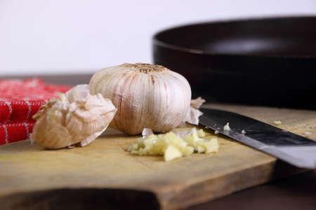food photography: Food photography closeup photo of garlic on chopping board Stock Photo