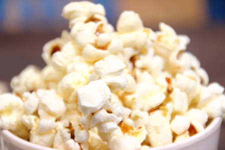 food photography: Food photography closeup photo of popcorn in white bowl Stock Photo
