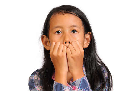 scared girl: Shocked and scared little girl closing her mouth with her hands isolated on white Stock Photo