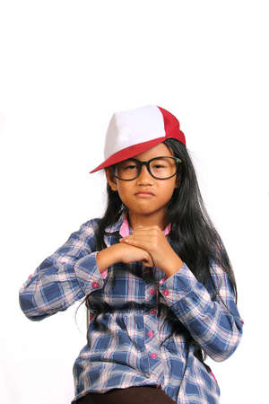 tough girl: Tough angry little girl with glasses and hat punching her fist into her palm isolated on white Stock Photo