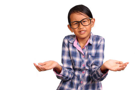 indonesia girl: Little girl with glasses performing shrug or I dont know gesture isolated on white