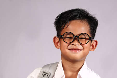 school kids: Happy Asian student boy wearing glasses with big smile on his face Stock Photo