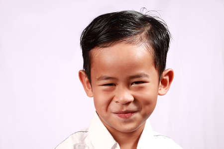 young boy smiling: Portrait of young Asian boy with adorable smiling on his face