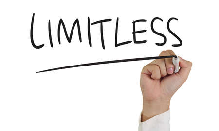 limitless: Business concept image of a hand holding marker and write Limitless isolated on white
