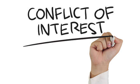 conflict: Business concept image of a hand holding marker and write Conflict of Interest isolated on white Stock Photo