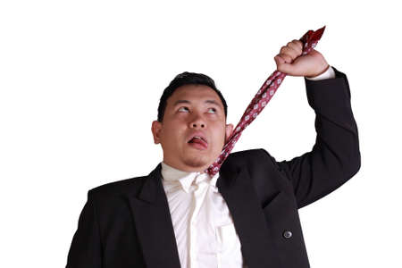 anger management: Business concept image of a stressed Asian businessman pulling his necktie to choke his own neck isolated on white
