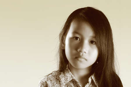 petite fille triste: Asian girl portrait with black long hair in sepia color