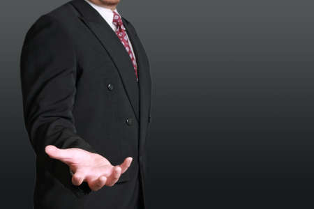 black business men: Business concept image of a businessman with open palm in position of holding something Stock Photo