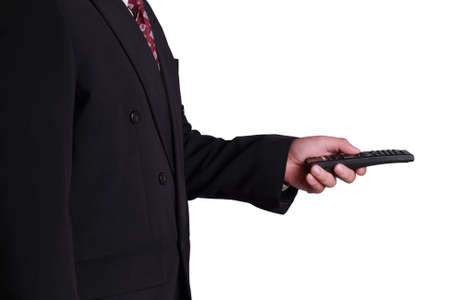 remote: Business concept image of a businessman holding and clicking remote control, side view isolated on white