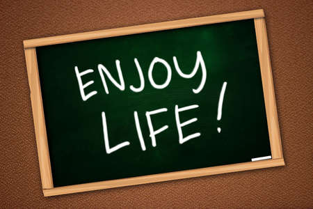enjoy life: Chalk board writing of Enjoy Life written on green blackboard over textured wall Stock Photo