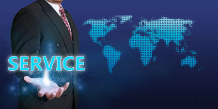 palmier: Business concept image of a businessman showing glowing Service word on his hand over blue background with dotted world map