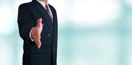 acceptance: Business concept image of a businessman offering hand shake over bright background