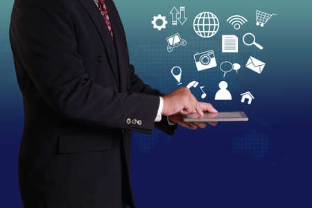 ecomerce: Businessman clicking tablet on his hand with some application icons fly over it