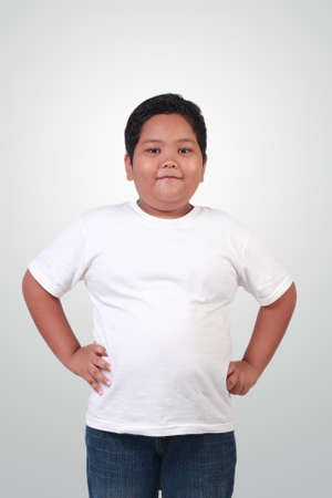 asian boy: Portrait of fat Asian boy wearing white shirt smiling happily