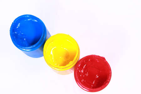primary colors: Colorful acrylic paints of primary colors red, yellow and blue Stock Photo