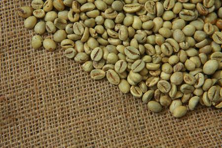 gunny: Raw coffee beans on gunny sack texture Stock Photo