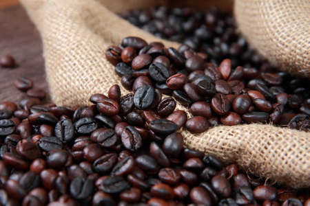 gunny: Dark roasted coffee beans in gunny sack close up image