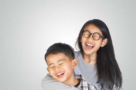 Portrait of young happy Asian brother and sister Stock Photo