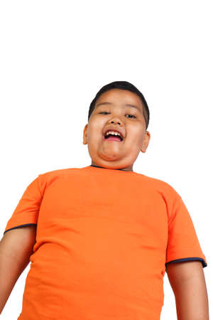 obesity kids: Half body portrait of happy and cute Asian boy smiling