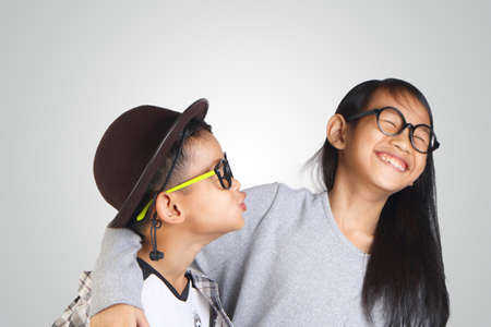 cool kids: Portrait of young happy Asian brother and sister Stock Photo