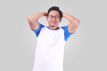 Photo image of funny Asian man crying close his eyes, sad depression frustration hopeless expression Фото со стока