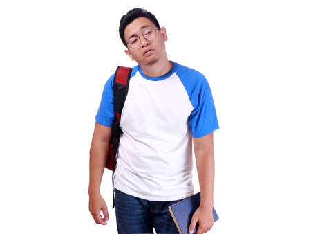 Portrait of young Asian student showing unhappy face, showing rejection or hopeless surrender gesture, isolated on white