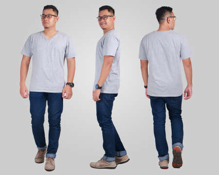 Attractive young Asian man standing posing wearing plain grey shirt, blank t-shirt mock up for  printing, front back side view 免版税图像