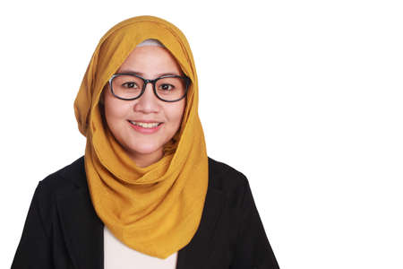 Portrait of muslim businesswoman wearing hijab and eyeglasses standing and smiling, isolated on white Stock Photo
