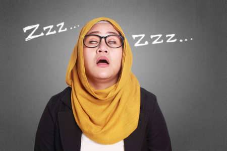 Portrait of muslim businesswoman tired and sleeping at work