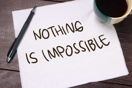 Nothing is Impossible. Motivational inspirational quotes words. Wooden background Фото со стока