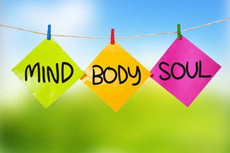 Mind Body Soul. Motivational inspirational quotes words. Colorful Paper with blurred background