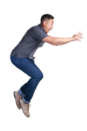 Levitation, funny attractive young Asian man jumping walking on the air Stock Photo