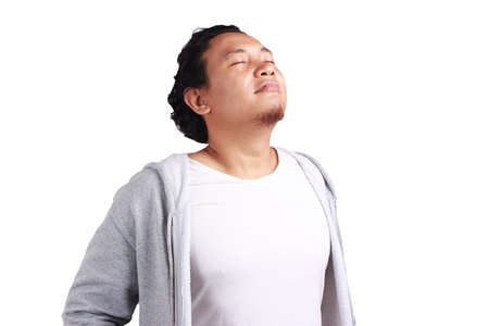 Portrait of young asian man feel relieved, Feeling relaxed, Happy to breathe fresh air