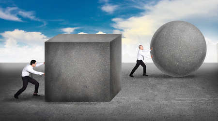 Business concept businessman pushing a sphere leading the race against a slower businessmen pushing box. Winning strategy, efficiency, innovation in business concept