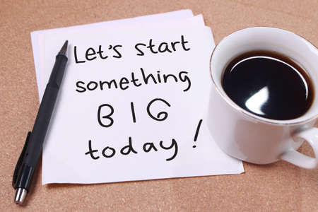 Lets start something big words letter, written on piece of memo paper, work desk top view. Motivational business typography quotes concept Stok Fotoğraf