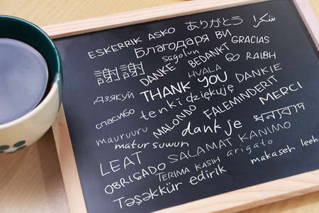 Thank you gratutide words letter in many languages, written on blackboard. Motivational business typography quotes concept Stock fotó