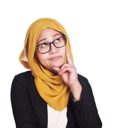 Asian muslimah businesswomen wearing glasses with curiousity thinking expression. Isolated on white. Close up head and shoulders