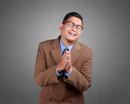 Young Asian businessman wearing suit regret, apologize gesture. Close up body portrait Reklamní fotografie - 108109707