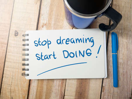 Stop Dreaming Start Doing, business motivational inspirational quotes, words typography top view lettering concept Stock Photo