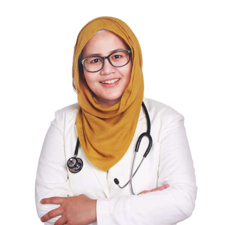 Portrait of happy smiling Asian muslim woman wearing hijab and suite. Confidence female doctor with crossed arms isolated on white, healthcare and medicine concept